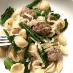 A delicious dish of hot orecchiette pasta with broccolini and meatballs